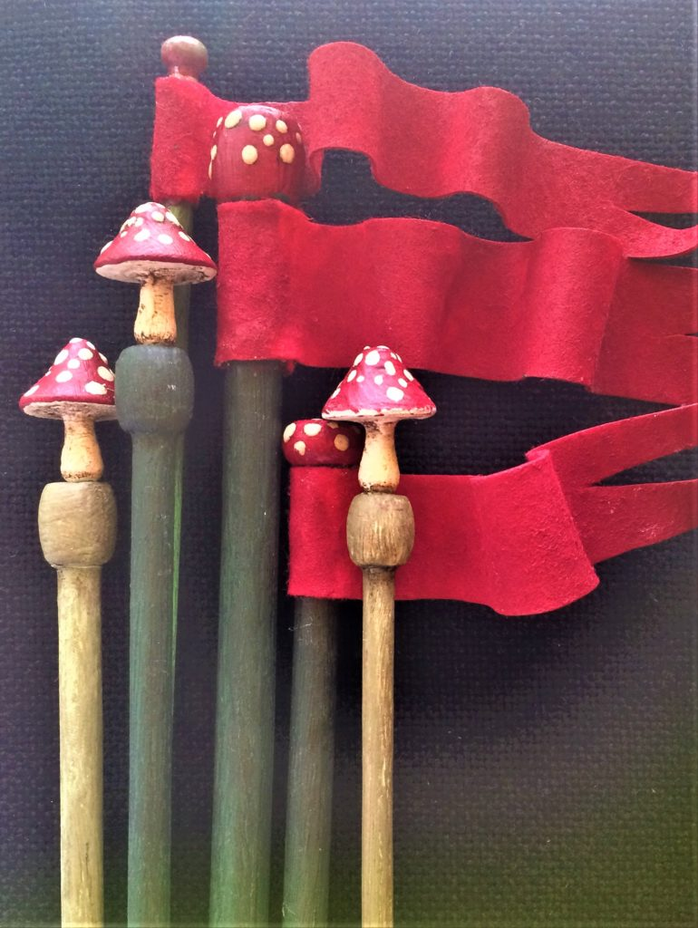 Mr Finch - Tiny toadstools gently sit on the ends of hand painted knitting needles.