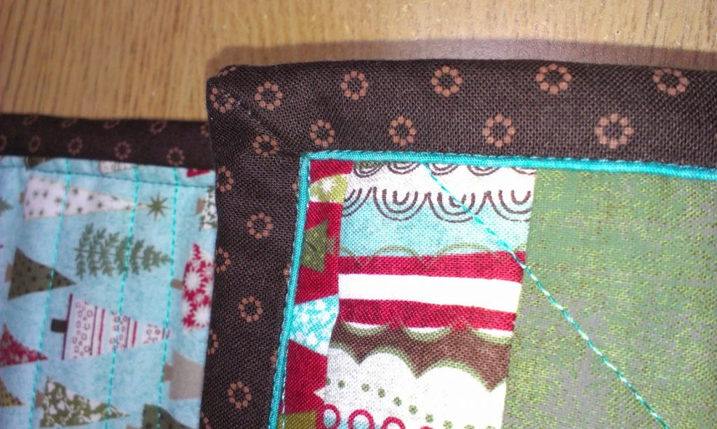 Ricky Tims piped binding on my Table Runner - corners complete