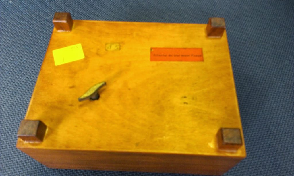music box - base of the box has a label and a key