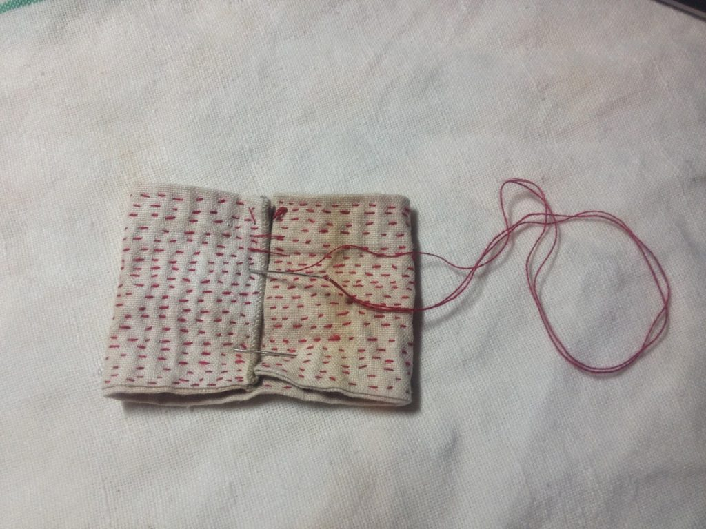 little red bow - I used the fabric I covered in Kantha stitches