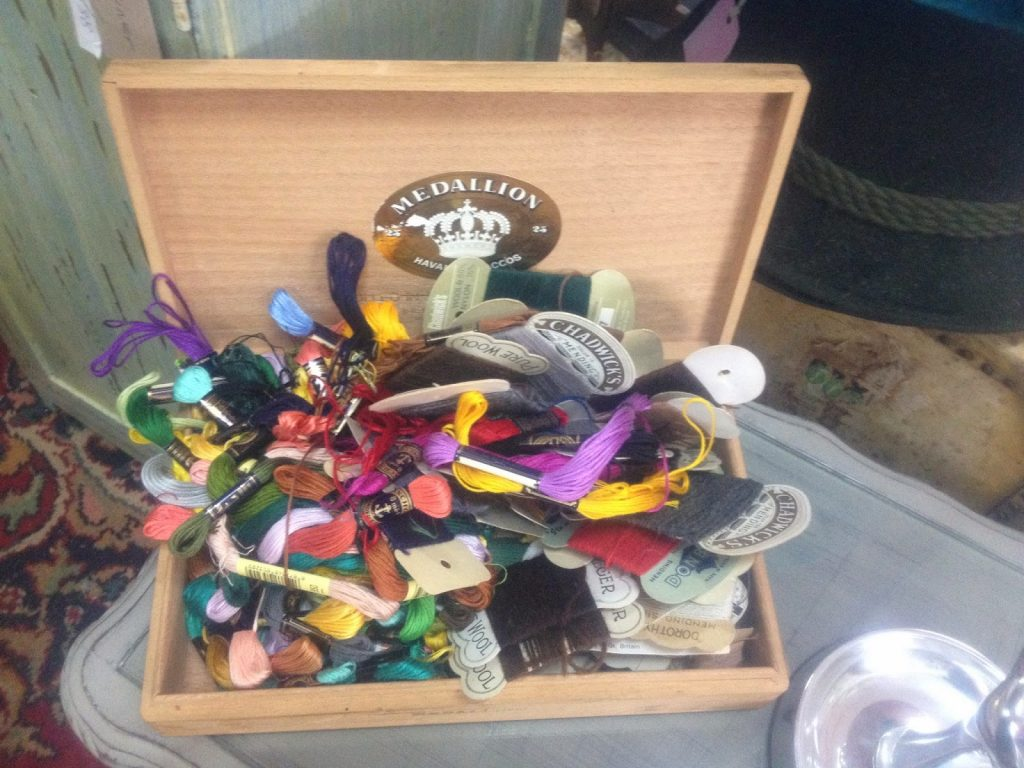 Vintage find- embroidery threads in a cigar box
