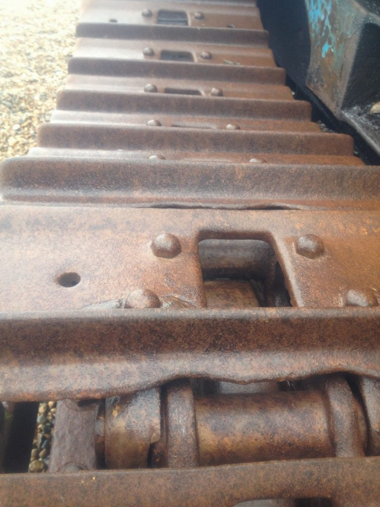 Rust on the beach - metal tractor tracks
