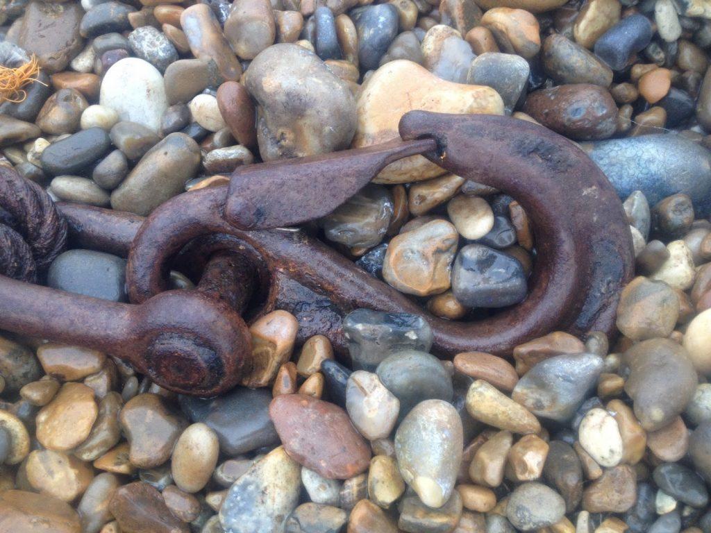 Rust on the beach - metal chain
