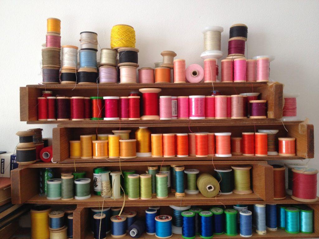 vintage, wooden cotton reel on thread rack