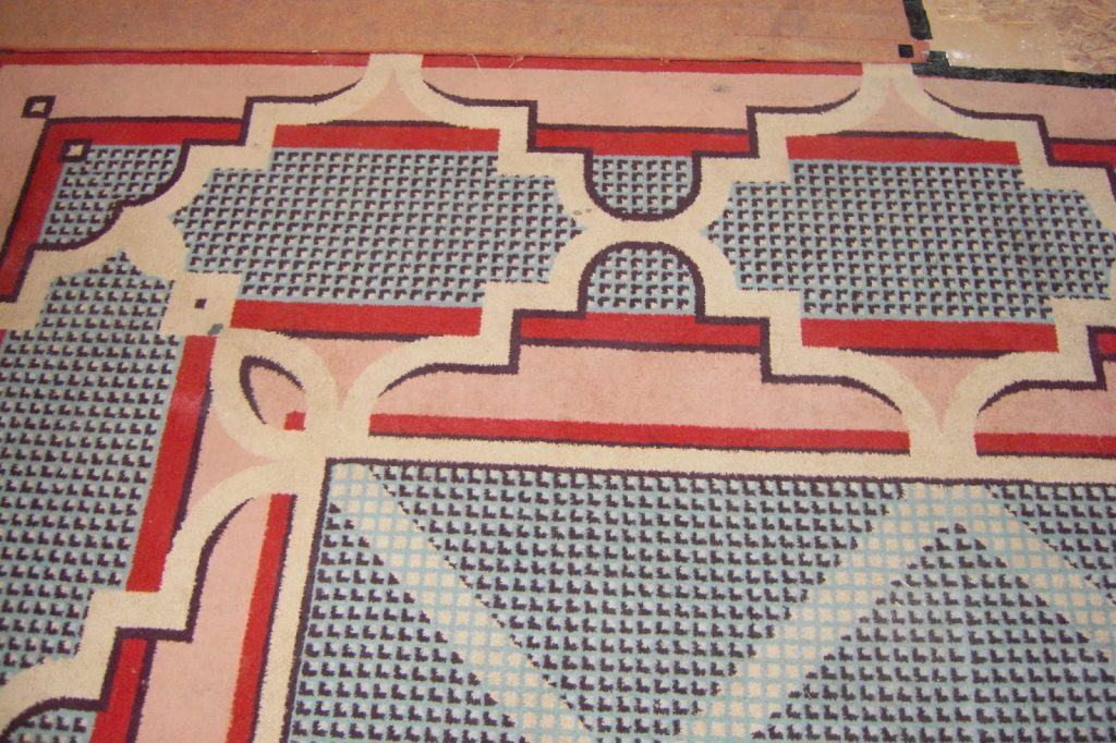 Original woven carpet from the entrance to the theatre