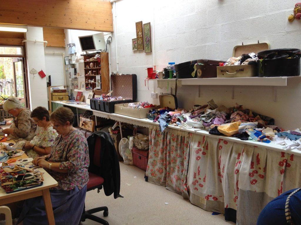 Students rummaging in the fabrics, designing and stitching