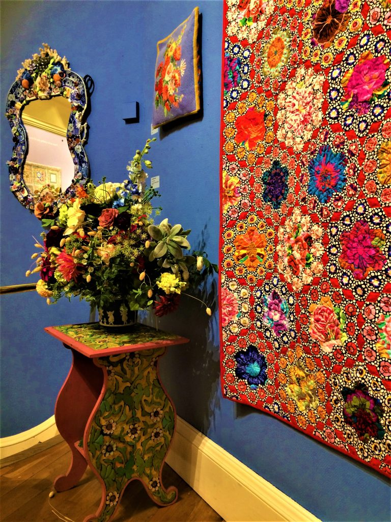 Kaffe Fassett quilt and mosaic mirror
