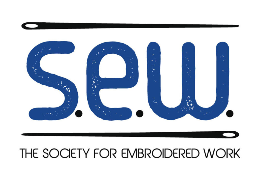 Logo featuring the letters S.E.W between two needles.