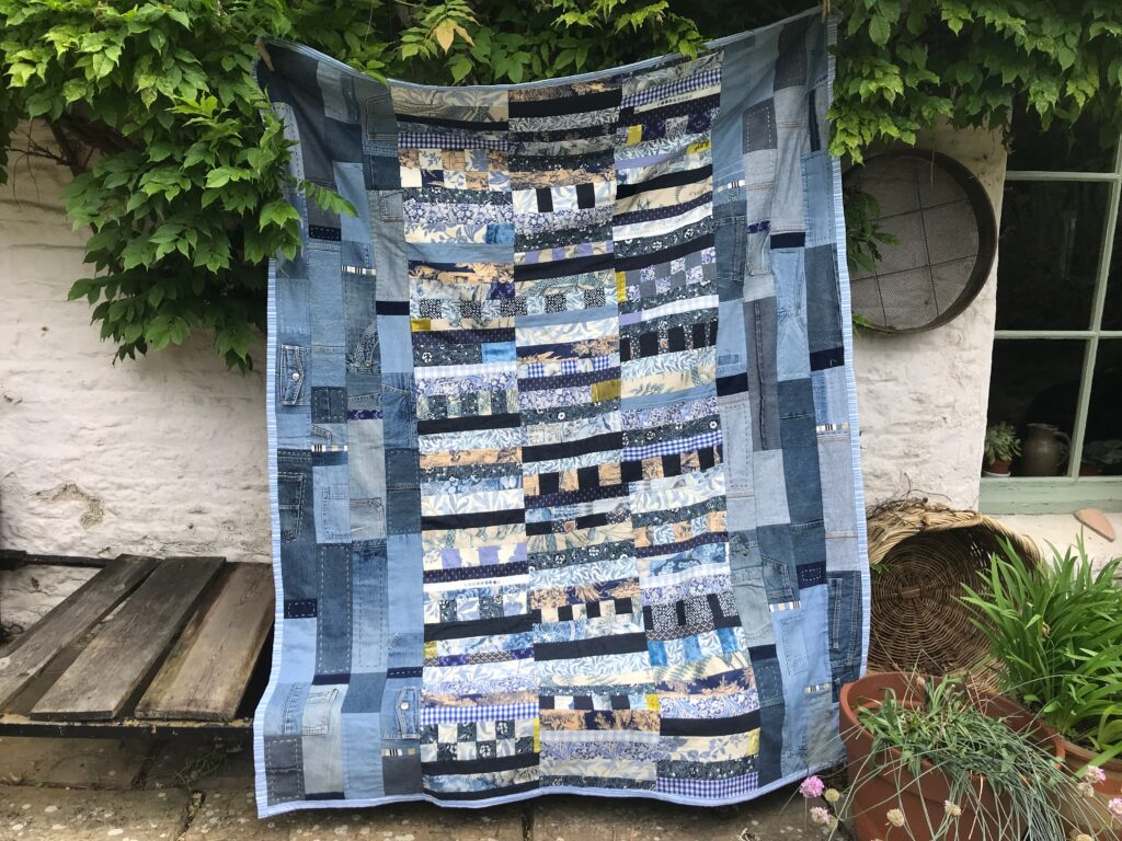 patchwork quilt made from old denim jeans and other cotton cloth by Christine Green