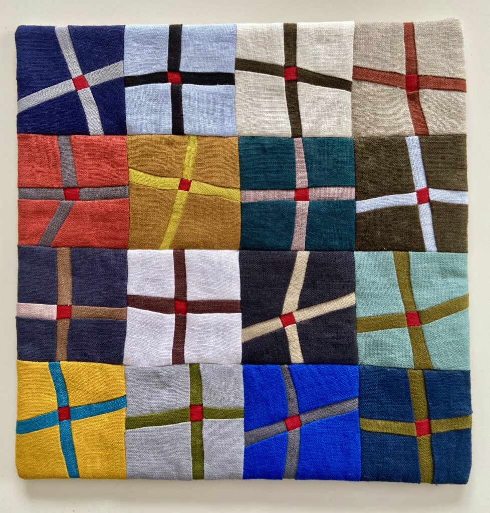 Crosses created in Linen cloth. Sarah uses all her scraps to create tiny artworks
