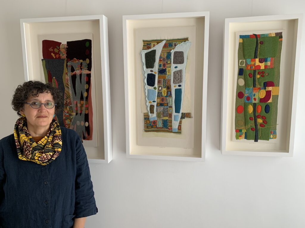 Sabine Kaner standing in front of her work