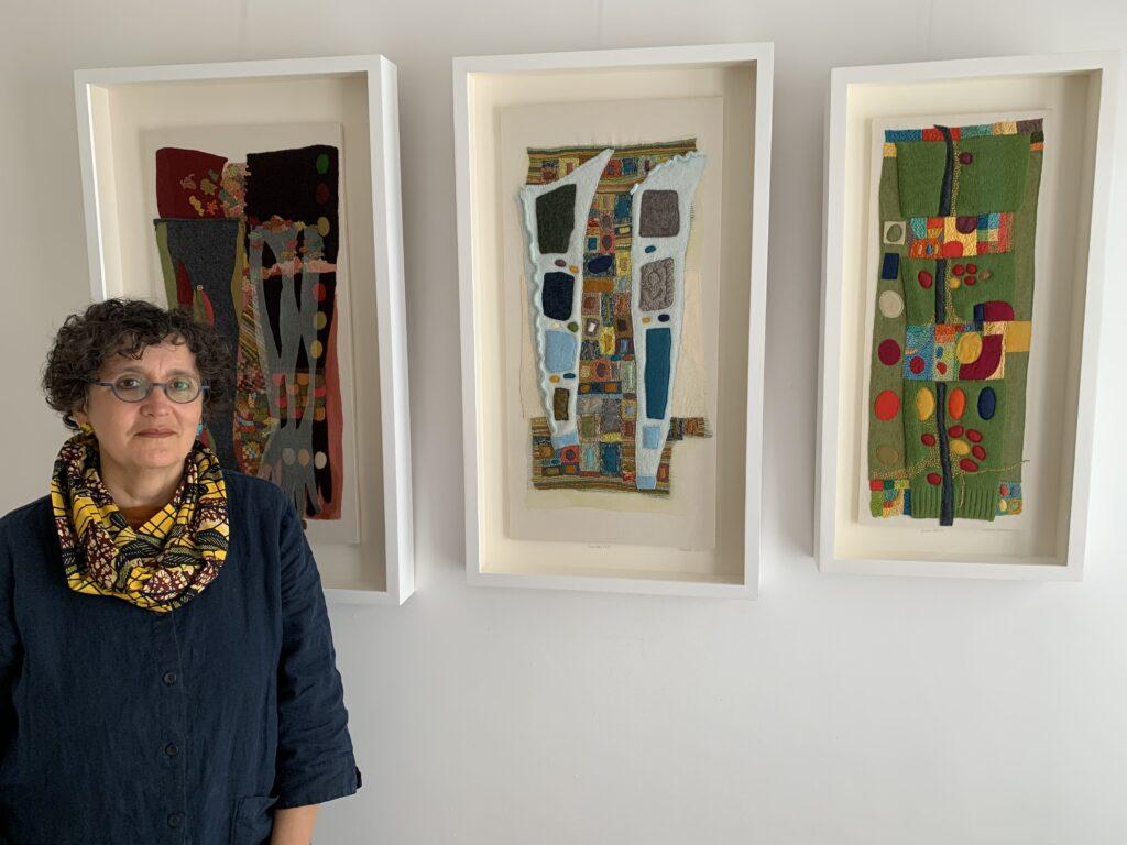 Sabine Kaner standing in front of her work