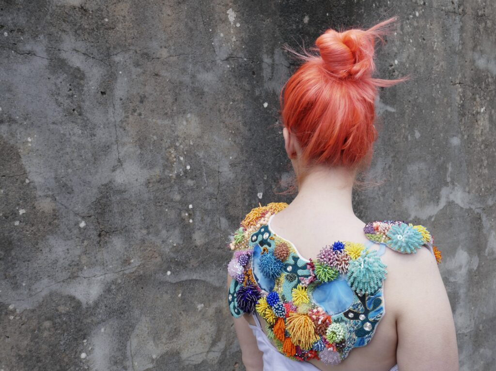 Heavily beaded collar inspired by the textures and colours of the Coral Reefs -  created by Claire Edwards