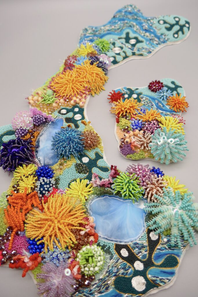 Heavily beaded collar inspired by the textures and colours of the Coral Reefs.