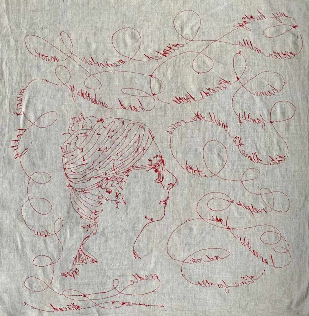 Hand embroidered  red thread in couching stitch.