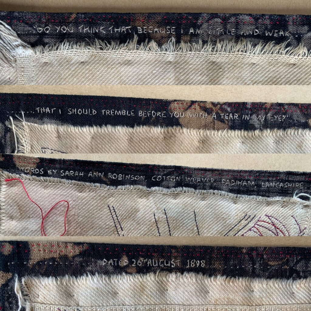 Hand embroidered words around the artwork
