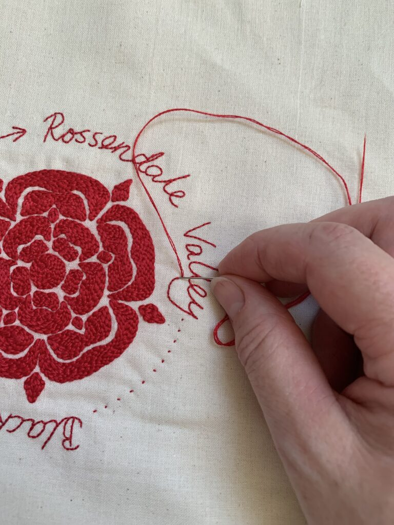 Stitch Your Story Exhibition - The final red stitch
