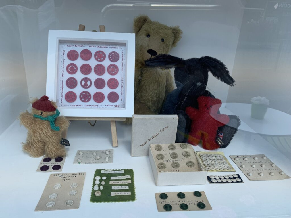 dorset buttons displayed on cards and in frames. red and natural colours, old  and modenn
