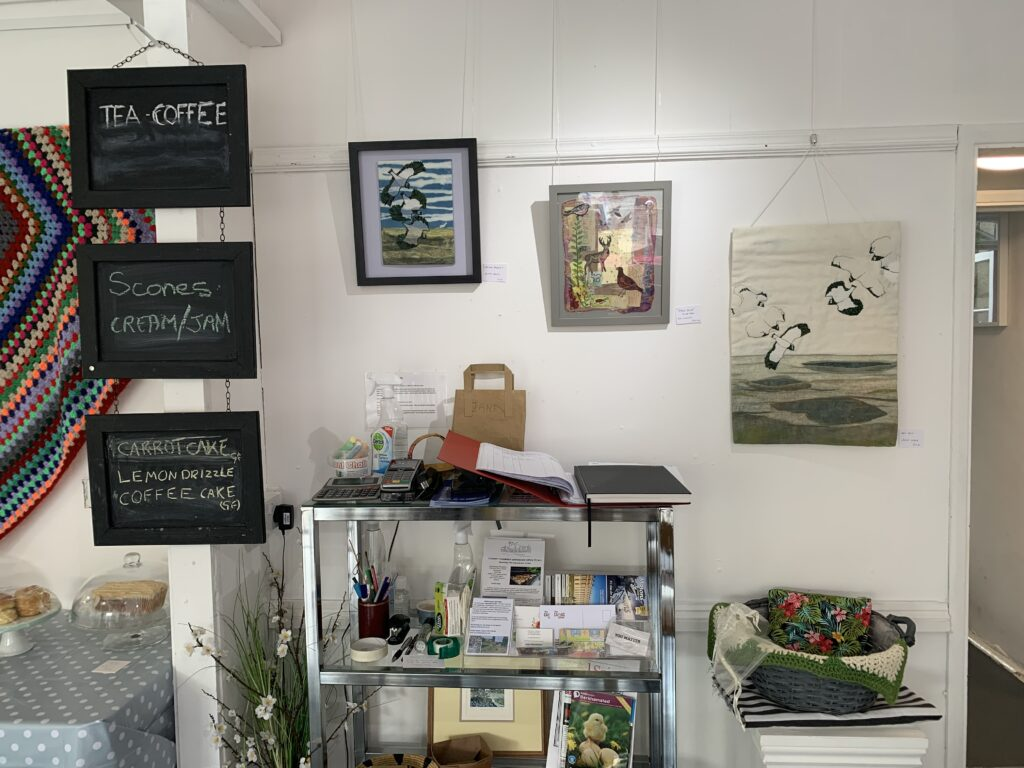 A collection of artwork on exhibition from textile artists