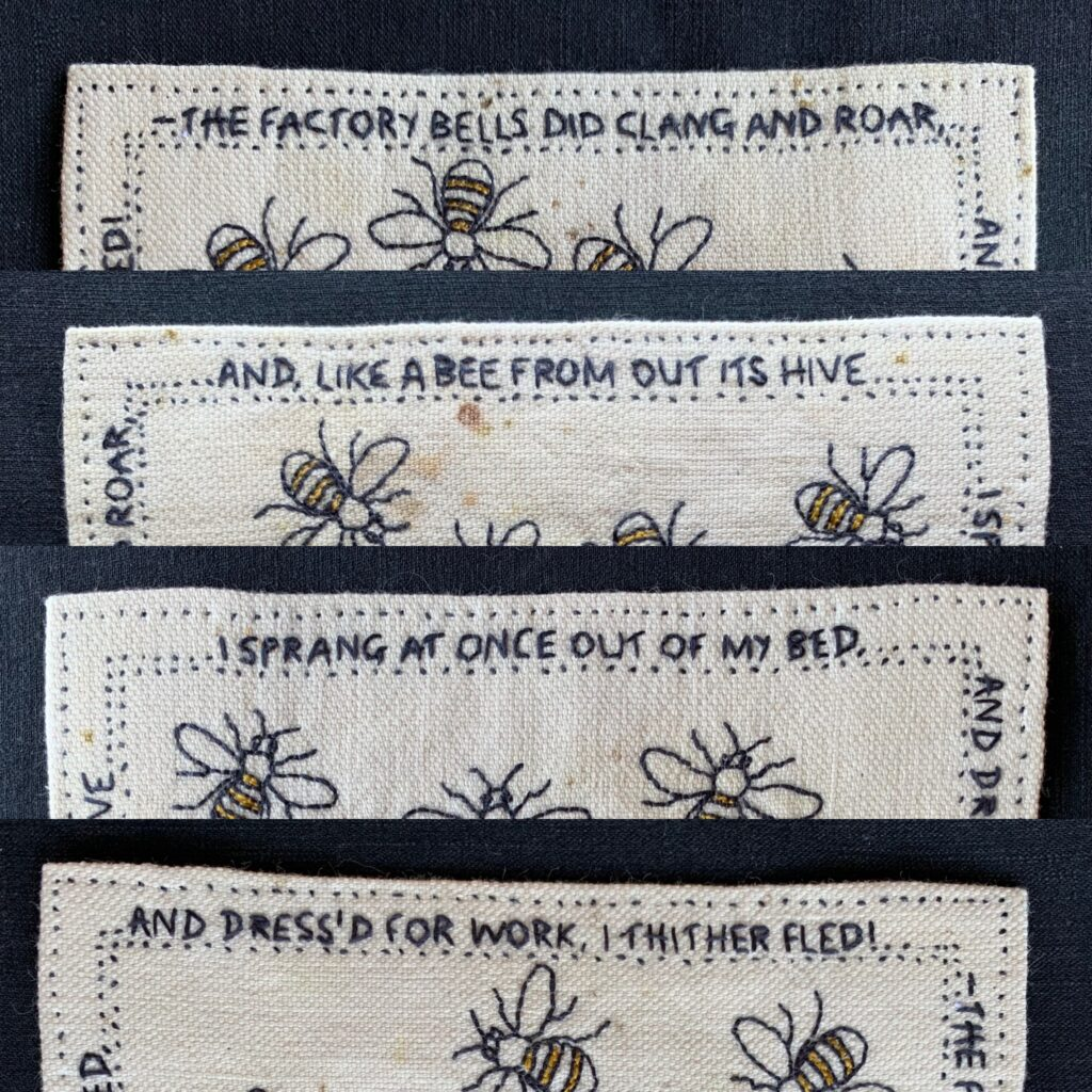 hand embroidered words around the outer border, words in Lancashire dialect from a poem written in 1864