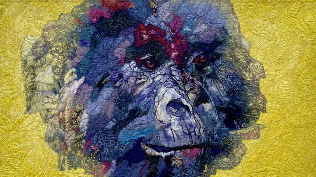 Testile art image of a gorilla on a yellow background