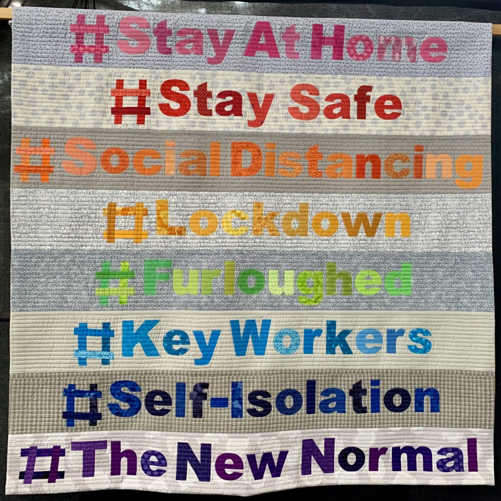patchwork quilt with words with hashtags stayathome, staysafe, keyworkers,