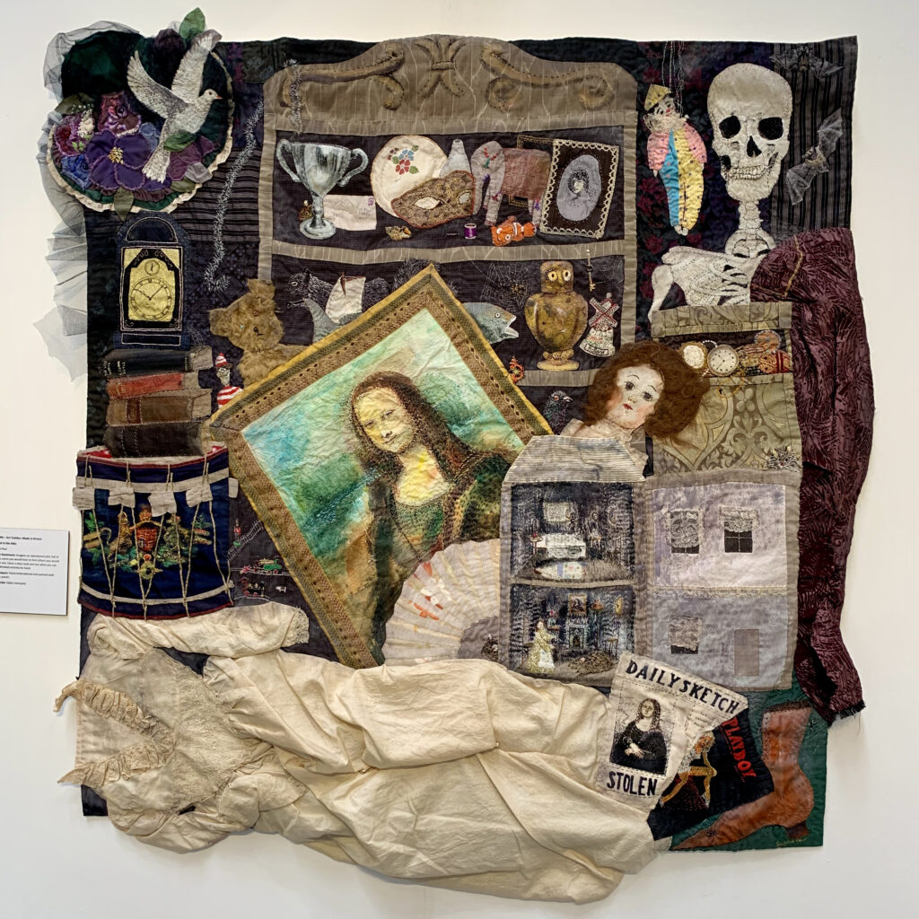 Artwork by Sylvia Paul - handmad quilt featuring images of theings found in an imaginery attic - a skull, Mona Lisa, spiders