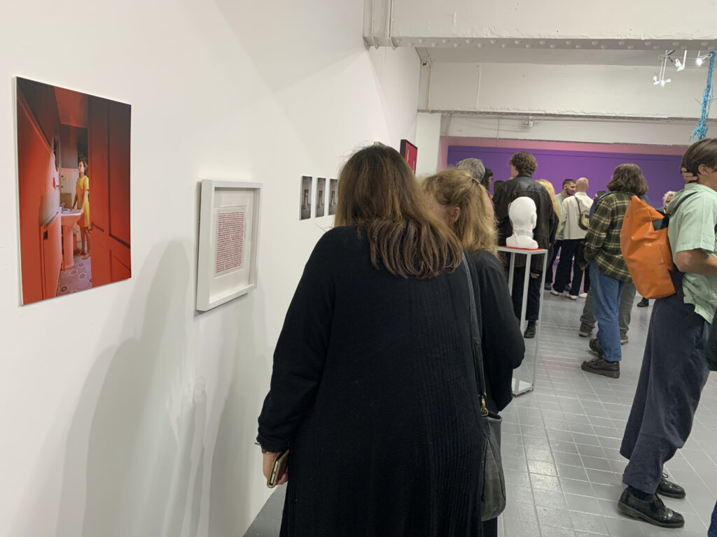 Bankley 2021 Opening Night  - people in the gallery space pausing to read The Sound of the Kenwood Chef